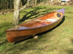 Eureka canoe just finished. dropped and made a hole. How to fix. storerboatplans.com