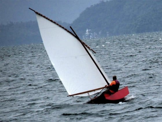 Polytarp sail in strong wind and big waves on Oz Goose. Storerboatplans.com
