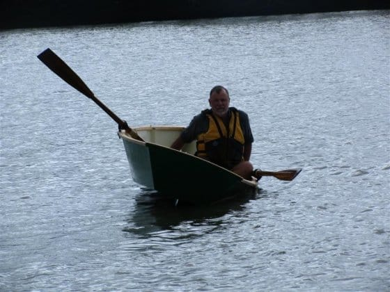 Storer rowboat version of Goat island skiff. Narrow waterline for travel but good stability