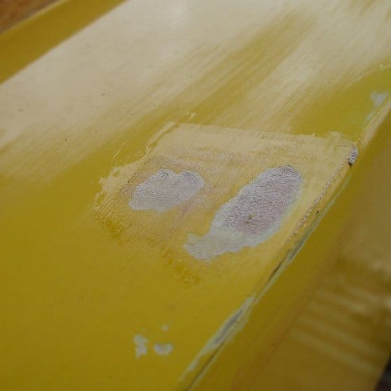 Fixing paint and holes in sailing dinghy. storerboatplans.com
